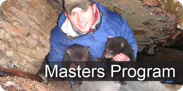 Photo of UK forestry graduate student with two bear cubs