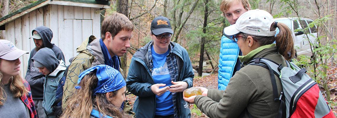 Photo of Laboratory Technician, Andrea Drayer, and spring field semester students