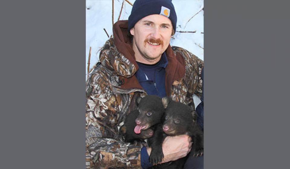 Photo of John Cox and black bears