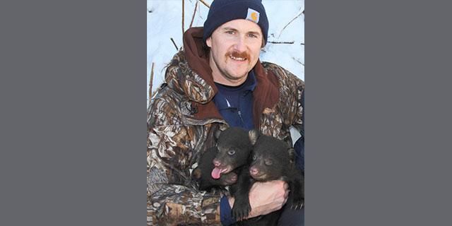 Photo of John Cox and bear cubs