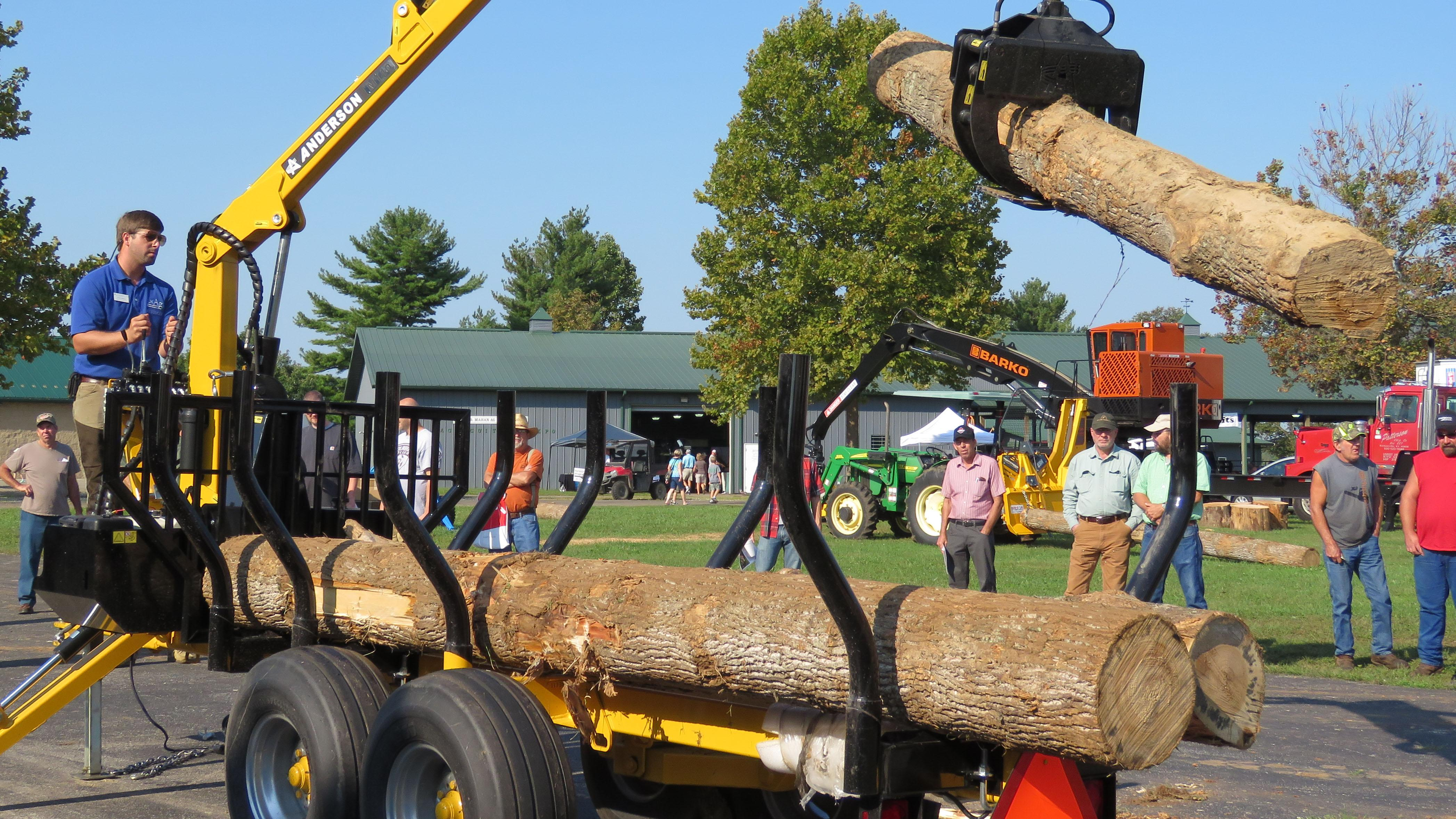 Photo of Chad Niman demonstrating small-scale logging.